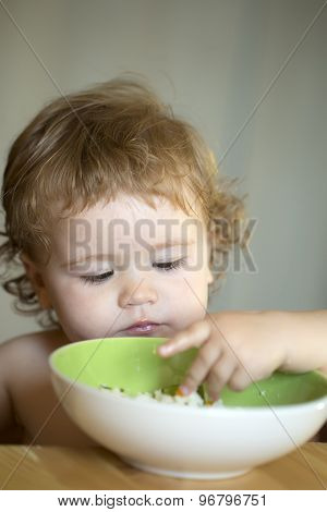 Portrait Of Small Male Kid Eating