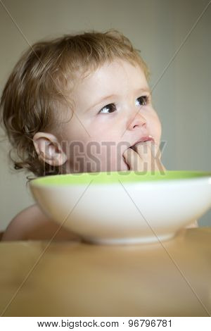 Portrait Of Curious Boy Eating