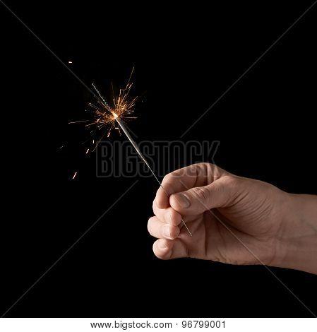 Holding a burning sparkler