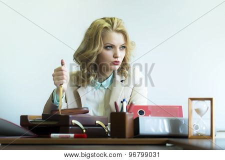 Serious Woman With Paper Knife In Office