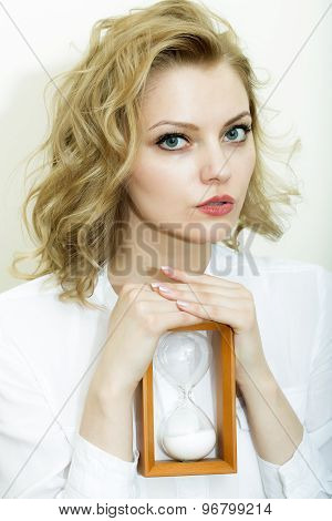 Portrait Of Woman With Sand Glass