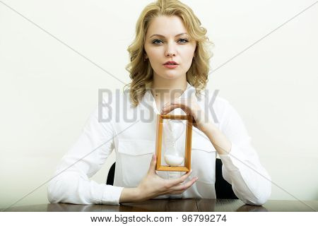 Attractive Woman With Sand Glass