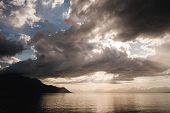 Постер, плакат: The Clouds At Sunset Over Lake