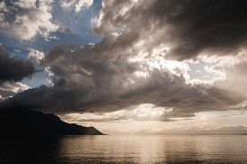 foto of cloudy  - sunset over the lake the sunset over the water evening sunset the sky at sunset the clouds at sunset sunset over the cloudy sky geneva lake - JPG