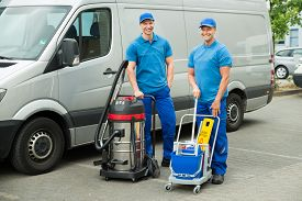 picture of sweeper  - Two Happy Male Cleaners Standing With Cleaning Equipments In Front Van - JPG
