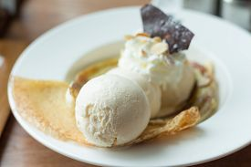 picture of crepes  - Crepe with ice cream and banana burned topping. A crepe is a type of very thin pancake (soft focus)