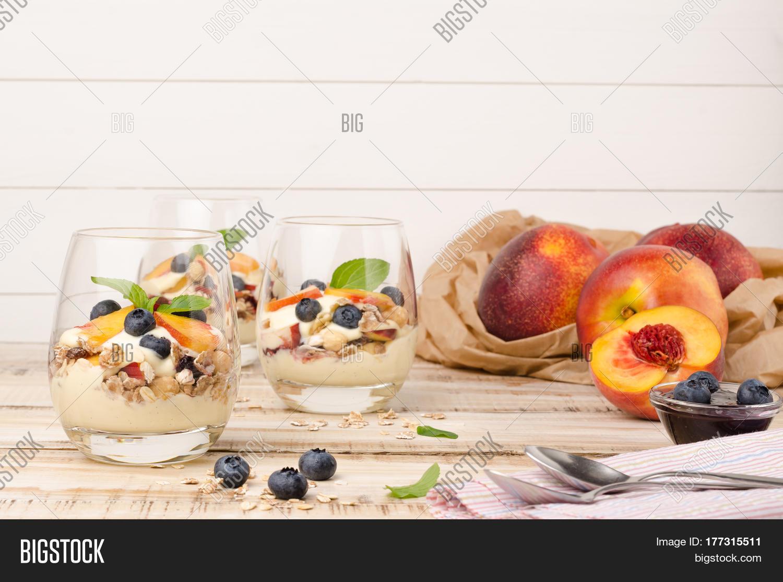 Granola Peaches Yogurt Blueberries Image & Photo | Bigstock