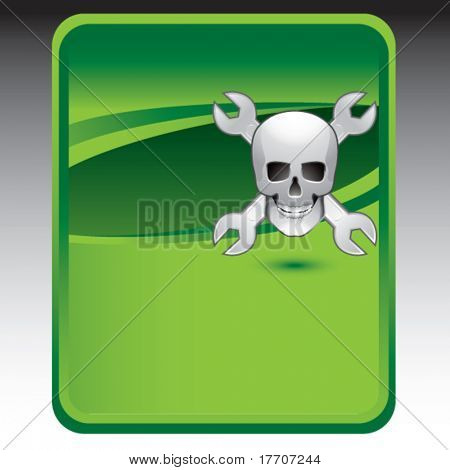 wrenches and skull on green background