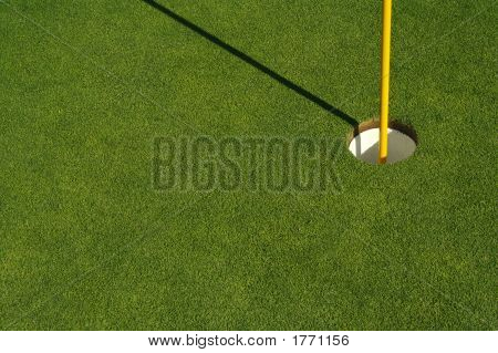 Fresh Cut Grass On Putting Green With Flag Stick And Cup.