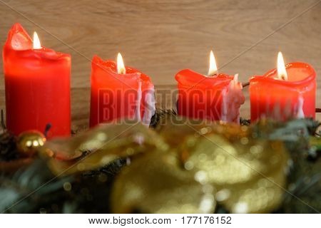 All four candles of the Advent wreath burn - close-up