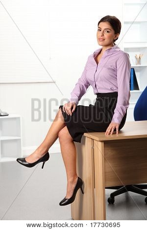 Relaxed woman sitting on office
