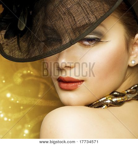 Fashion Woman over luxury gold background