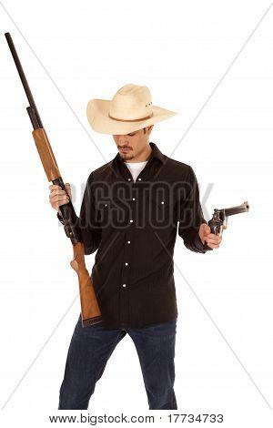 Cowboy Holding Two Guns