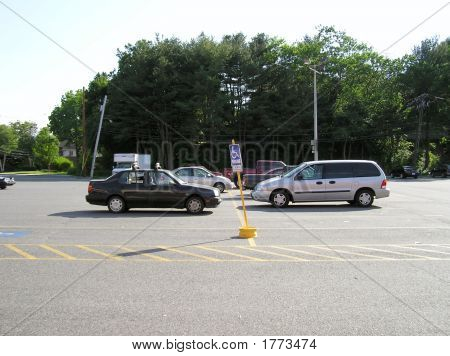 Parking lot with two 2 cars