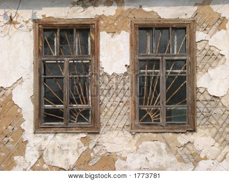 Two Aged Ruined Urban Windows