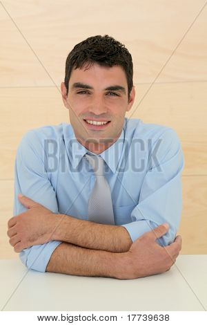 Portrait of smiling salesman with arms crossed