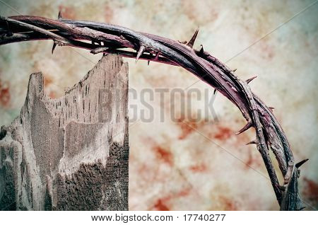 closeup of crown of thorns and the cross of Jesus Christ