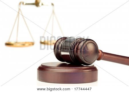 Gavel and scale of justice on a white background