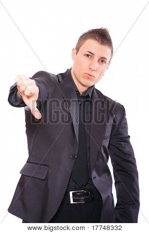 Elegant business man in a suit thumb down - isolated over a white background