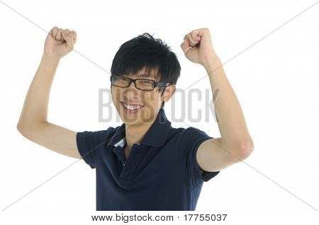 Man clenching his fists and laughing