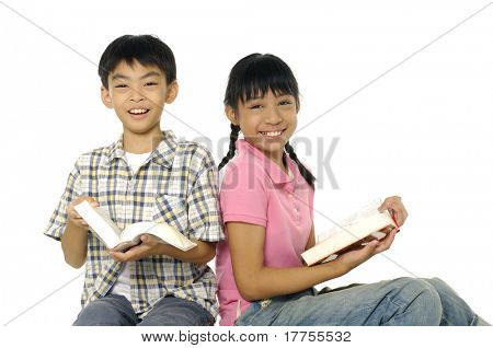 Two friends reading a book