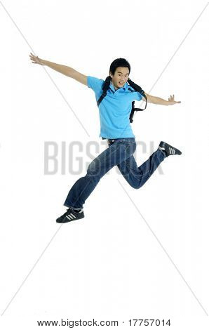Excited Young man jumping in mid air cheering and celebrating his success