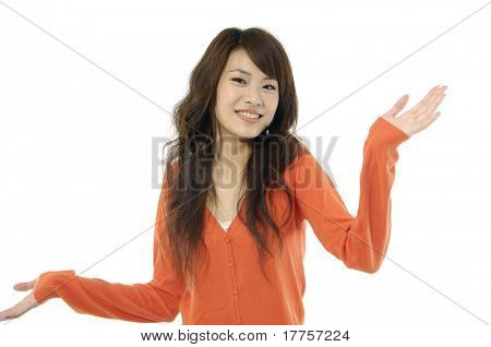 Young Asian woman shrugging her shoulder, isolated on white