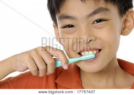 boy cleaning teeth. Isolation on white