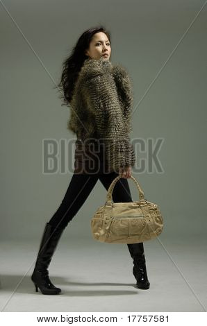 Asain fashion model Posed on light background in nice dress