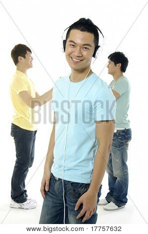 Asian happy university students over a white background-focus on man in blue
