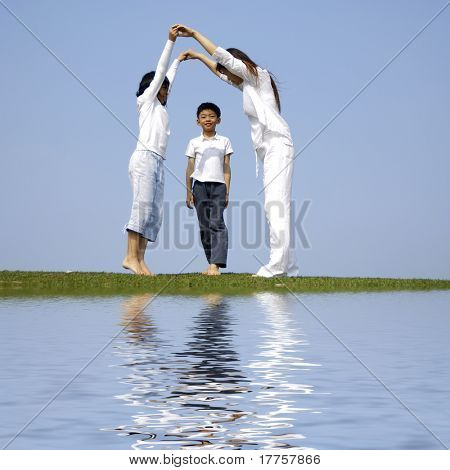 family under blue sky with reflection