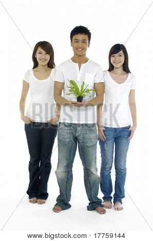 Young man on holding a small plant and two beautiful girl