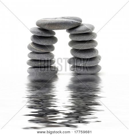 Abstract triumphal arch from a natural stones with reflection