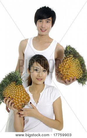 Young love couple with pineapple