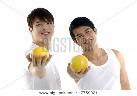 Asian young man holding grapefruit