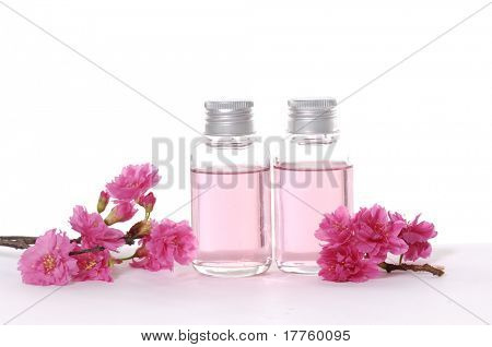 A bottle of massage oil with red flower