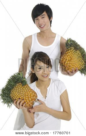 Happy couple with pineapple