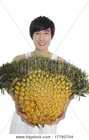 Asian young man showing a healthy fruit