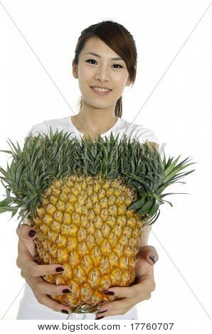 Asian young woman showing a healthy fruit