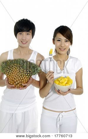 Couple eating and hold pineapple