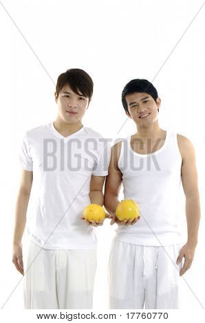 Asian couple young man holding grapefruit