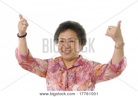 Asian senior woman with thumb up