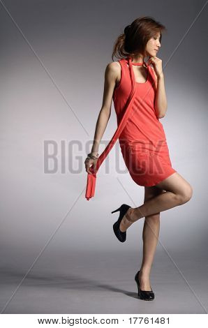 model posed on light background in nice dress