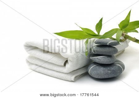 pyramid of stones with towel and leaf