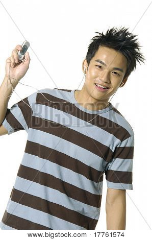 young man listening to mp3 music over white - focus on mp3 player