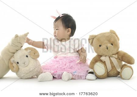 Small girl with animal toys