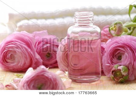 Dahlia flower and spa bottle on mat