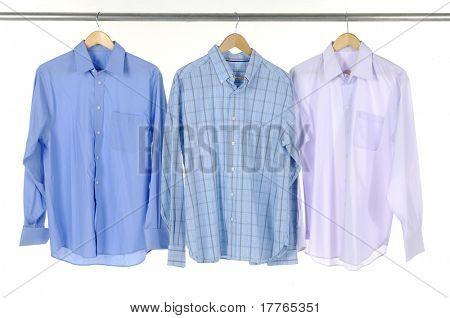 Close up of three blue shirts