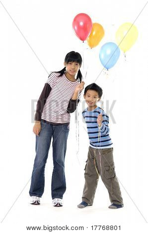 Couple children with colorful balloons on white