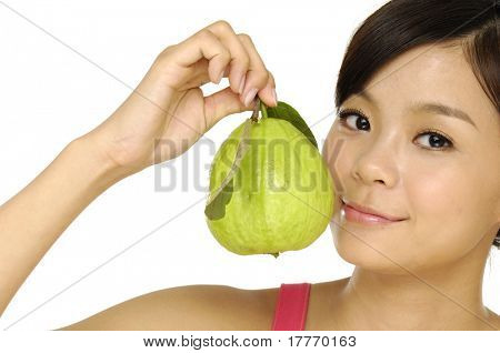 Close up young woman holding guava fruit
